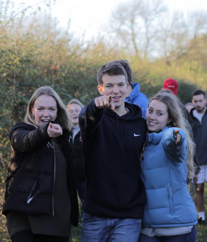 Young people pointing at camera